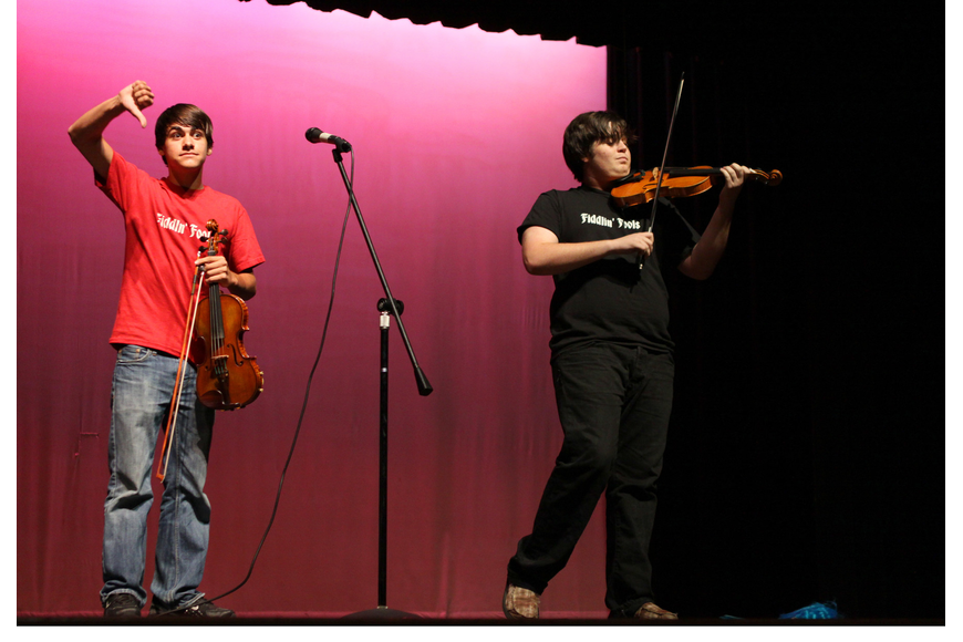 Alex Hunsader tries to get the audience to boo fellow fiddler, Nick Gamardella.