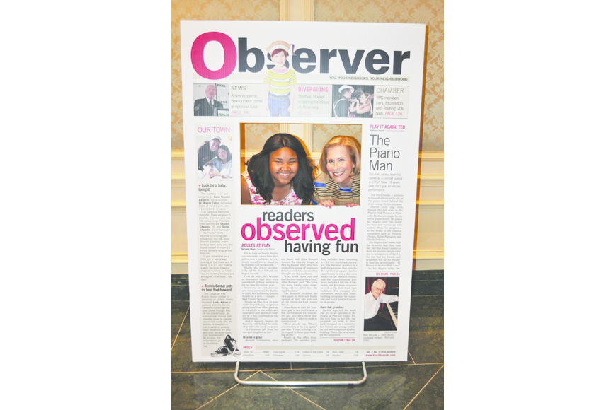 Zandy Sanders and Lisa Walsh pose inside the front cover of The Observer at Girls Inc's Celebration Luncheon April 4, at The Ritz-Carlton, Sarasota.