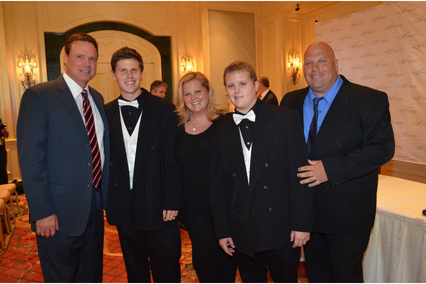 University of Kansas head men's basketball coach Bill Self with Cody, Denise, Dillon and Shawn Simmons