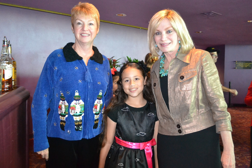 Managing Director Mary Ann Servian, Dance Next Generation student Melanie Gonzalez and board chair Hillary Steele