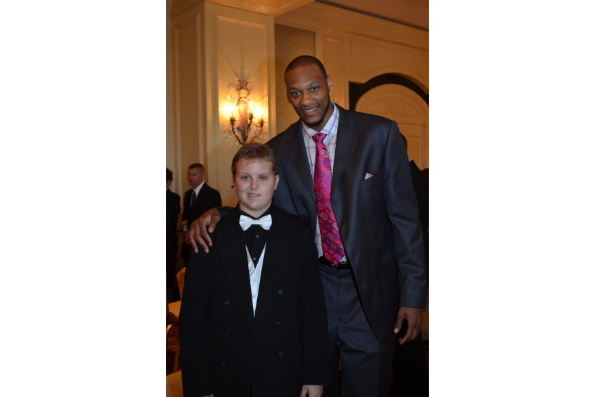 Dillon Simmons with Michigan State basketball player Adreian Payne