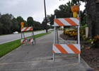 Barricades denote places where sections of the sidewalk have lifted along Lakewood Ranch Boulevard.