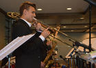 Ben Lafo, trombone player for the Sarasota Youth Orchestra, performs for attendees.