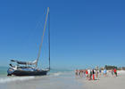 A large sailboat ran aground on Siesta Key Beach this week.