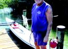 John Crimaldi on the dock behind Whitney Beach with his rowing shell